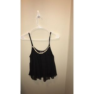 Black tank top with flowers lining the top